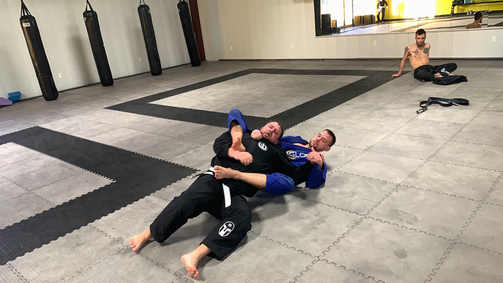 Getting strangled in jiu jitsu - white belt beginners